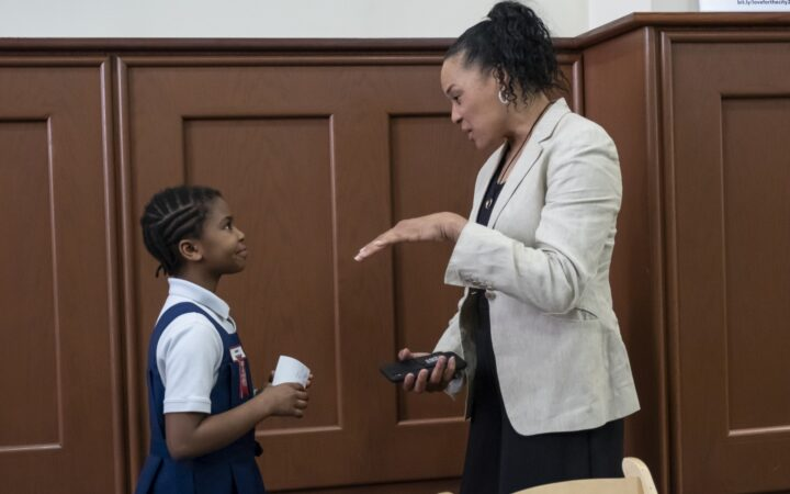 Dawn Staley talks to young African American girl