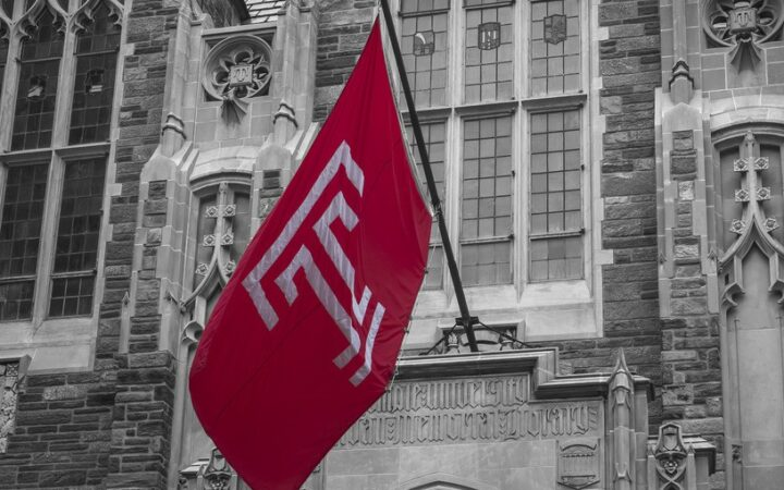 Red Temple Flag outside of black and white Sullivan Hall